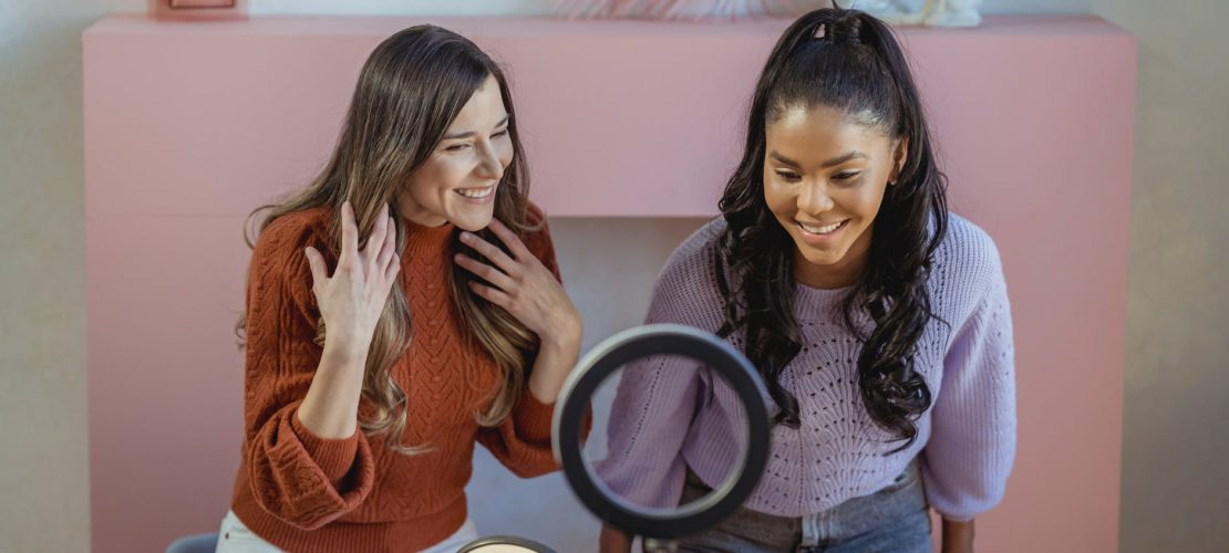 cheerful multiracial women recording beauty video