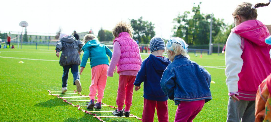 children s team building on green grassland