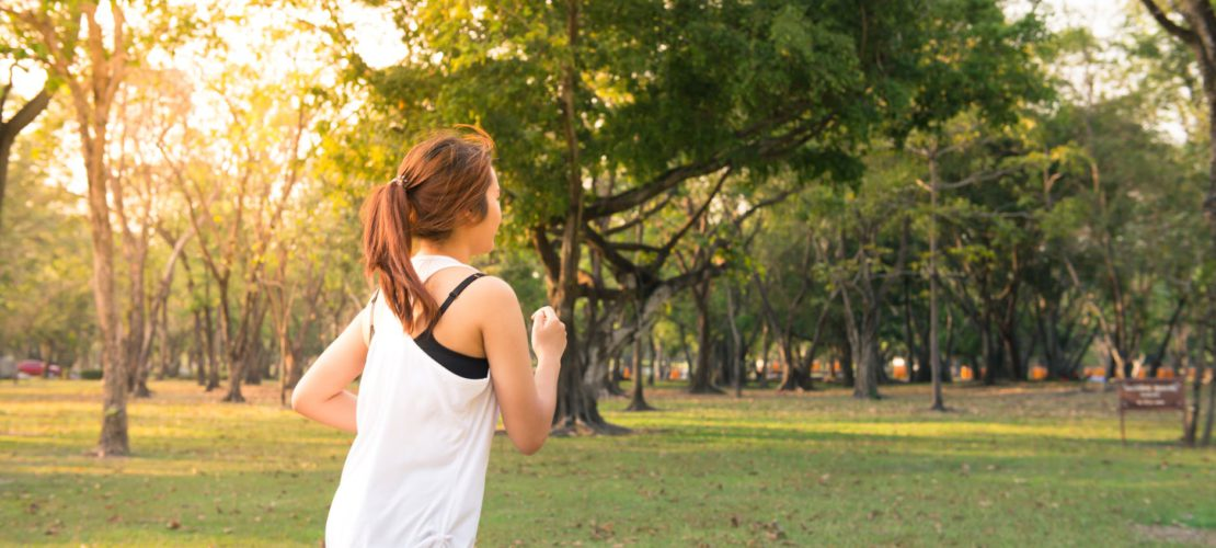 woman about to run during golden hour